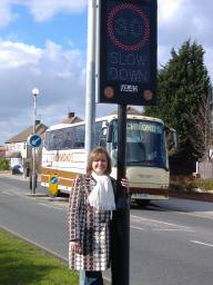 Cllr Chilvers with a Vehicle Activated Sign in Havering