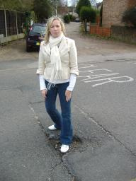 Nina at the pothole in Woodman Road