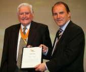WELL DONE: Former mayor Derek Hardy receives his award from Simon Hughes MP