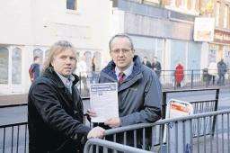 STRUGGLING BUSINESS?: Councillor David Kendall passes a survey to Hair Company owner Nigel Clarke. Picture by Martin Dalton