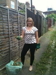Cllr Karen Chilvers bags up one of the ten bags of green waste