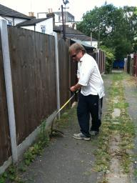 Cllr Nigel Clarke gets to work with the strimmer