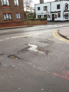 Pothole at King's Chase/Kings Road junction, Brentwood West (Cllr Karen Chilvers)