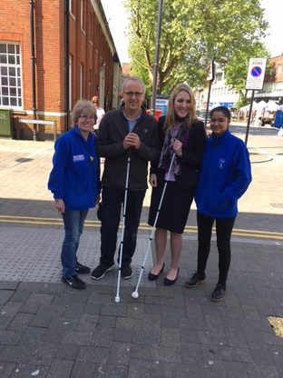 Cllr David Kendall takes part in a blindfold challenge in Brentwood High Street